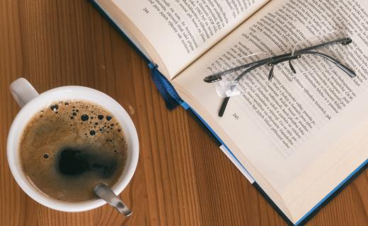 A Book, Reading Glasses, and Coffee