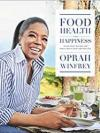 Oprah Winfrey at a table, enjoying delicious food made from a recipe in this cookbook.