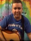Joel playing guitar