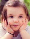 Toddler girl looking at camera